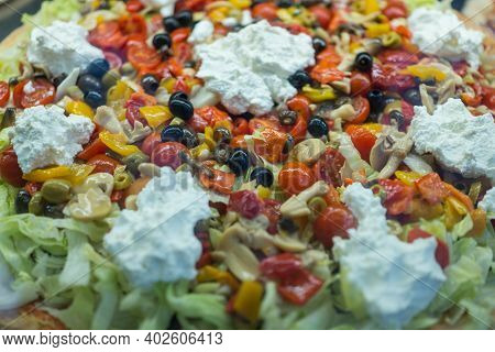 A Pizza With Many Different Toppings. High Quality Photo