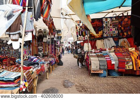 Pisac, Peru - September 04, 2016: Colourful Goods For Sale In Marketplace In Pisac, Peru On Septembe