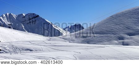 Panoramic View On Snowy Off-piste Ski Slope With Trace From Skis And Snowboards In Sunny Winter Day.