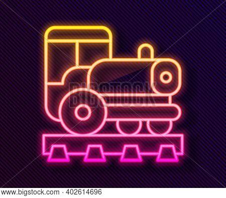 Glowing Neon Line Vintage Locomotive Icon Isolated On Black Background. Steam Locomotive. Vector