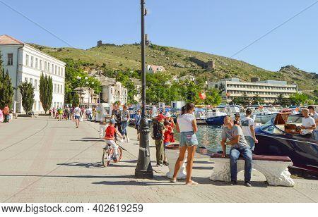 Balaklava, Sevastopol, Crimea, June 02, 2018: The Embankment In The Balaklava Bay. Yachts, Boats And