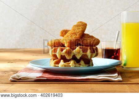 Chicken Tenders Strips With Belgian Waffles On A Plate With Napkin