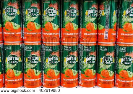 Tyumen, Russia-november 20, 2020: Perrier Juice Carbonated Drinks. Aluminum Can Strawberry Kiwi