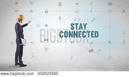 Engineer working on a new social media platform with STAY CONNECTED inscription concept