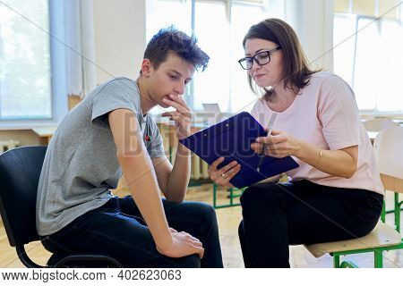 Woman School Psychologist Talking And Helping Student, Male Teenager. Mental Health Of Adolescents,