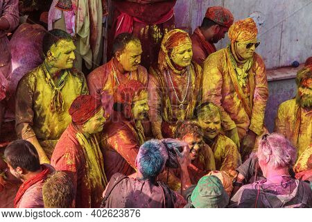 Mathura, Uttar Pradesh/ India- January 6 2020: Group Of Happy Friends Playing With Holi Colors Faces