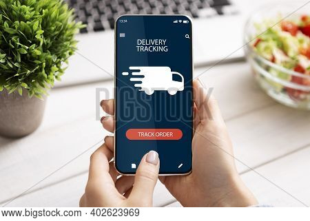 Track Your Order Online. Point Of View Of Young Woman Holding And Using Smartphone With Delivery Tra