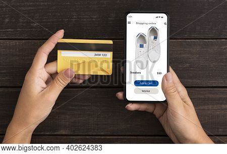 Ecommerce Concept. Above Top High Angle View Of Woman Holding Credit Card In Hand And Using Mobile P