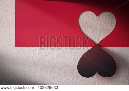 Love And Relationship Concept. Heart Shape On Red Paper Hanging On The Wall. Plenty Of Copy Space