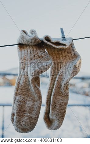 Clean Woolen Socks Are Put On The Street In The Courtyard Of A Village House.