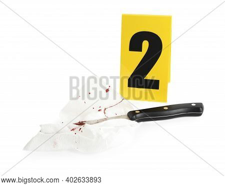 Bloody Knife, Napkin And Crime Scene Marker With Number Two Isolated On White