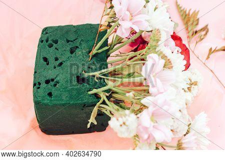 Flower Arrangement In Floristic Foam (oasis) To Preserve Plant Moisture.