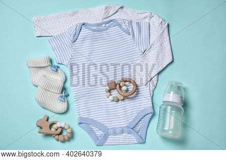 Flat Lay Composition With Cute Baby Items On Cyan Background