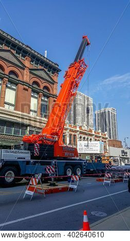 Chicago, Il April 24th, 2016, Orange Construction Crane Parked On Clark Street Outside Of Germania P