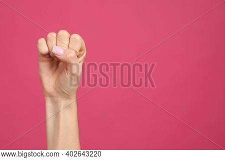 Closeup View Of Woman Showing Fist As Girl Power Symbol On Pink Background, Space For Text. 8 March
