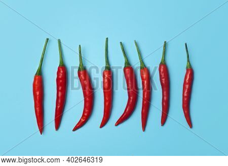 Chili Peppers On A Colored Blue Background. Red Hot Chili Peppers As An Ingredient Of Asian And Mexi