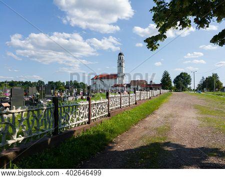 Derventa - Bosnia And Herzegovina - June 24, 2020: All Saints Orthodox Church And Graveyard In Bosan
