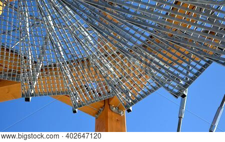A Metal Lattice Grate Is Used For The Outdoor Spiral Staircase. The Galvanized Grate Is Transparent,