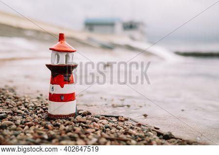 Frozen Winter Sea With Decorative Lighthouse. Nautical Lifestyle. Winter, Sea, Travel, Adventure, Ho