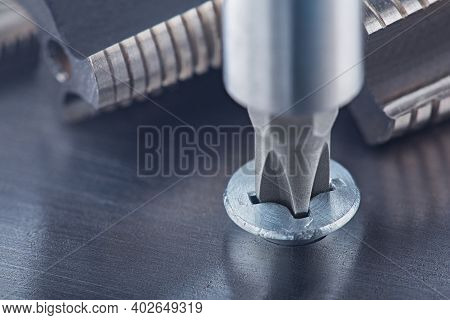 Screwdriver Screw In Metal Steel Plate Bolt. Spanner, Bolt, Screw And Nuts.