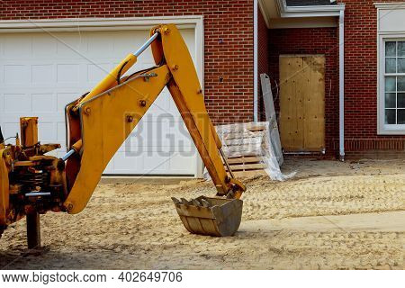Industrial Excavator Bucket Machine In During Earthmoving Works With Under Construction Residential
