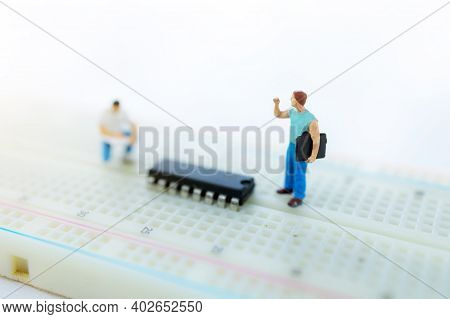 Miniature People Searching Or Checking For Bugs And Issue On Microchip, Mainboard Of Computer. Vulne