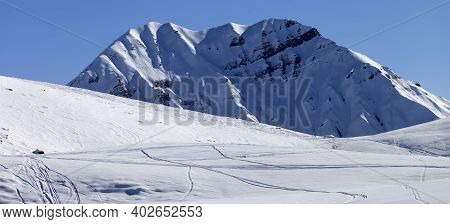 Panoramic View On Snowy Off-piste Ski Slope With Trace From Skis And Snowboards In Sun Winter Mornin