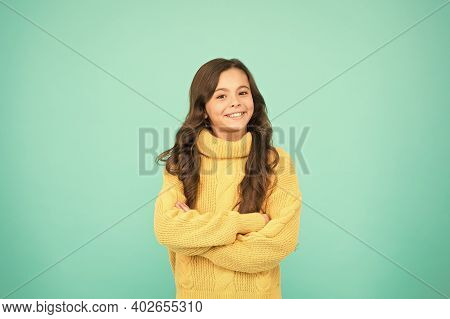 Positive Mood. Kids Psychology. Adorable Smiling Girl Wear Yellow Sweater Turquoise Background. Posi