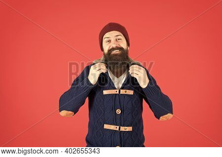 Male Fashion Concept. Man Bearded Hipster Stylish Fashionable Jumper And Hat. Hipster With Long Bear