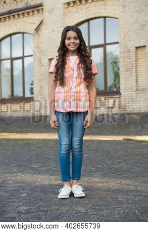 Be Yourself, Be Anything. Happy Child Stand In Yard Outdoors. Beauty Look Of Child Girl. Hair Salon.