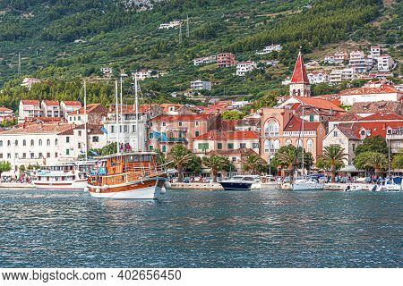 Makarska Riviera, Croatia - 1 July, 2017: View Of The Port Of The Resort Town Of Makarska In The Sum