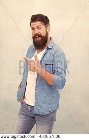 Check It Out. Promoting Goods. Handsome Man With Beard Pointing Index Finger. Promotion Concept. Dir