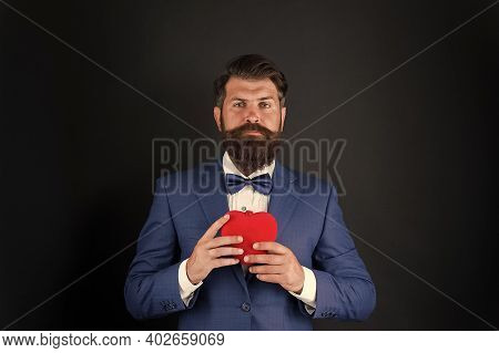 Valentines Day. Well Groomed Handsome Bearded Man Wear Tuxedo. Romance And Dating. Gentleman Romanti