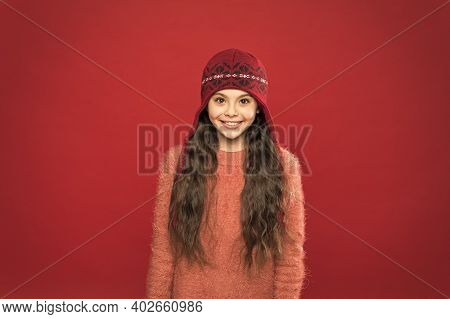 Get The Style Just Right. Happy Child Enjoy Warmth In Soft Knit Style. Little Cute Girl In Winter St