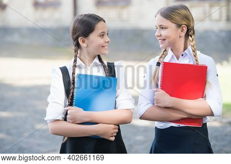 Happy Kids In School Uniform Hold Study Books Outdoors, Library.