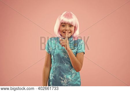 Little Child Show Hush Gesture. Small Chinese Girl In Wig. Kid In Traditional Chinese Gown. Spring S