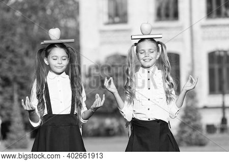 Relaxing Organic Food Break. Calm Children Hold Books And Apples On Head. School Snack. Organic Food