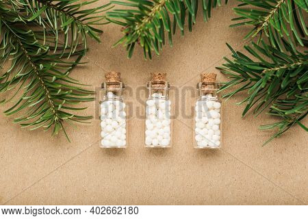 Homeopathy Border Background, Globules In Bottles And Pine On Cork Background. Naturopathy And Alter