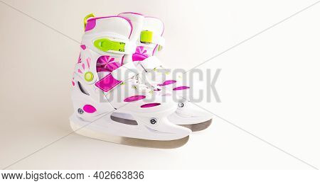 Children's Ice Skates With Size Adjustment-sliding With Fixation. Plastic Skates On A White Backgrou