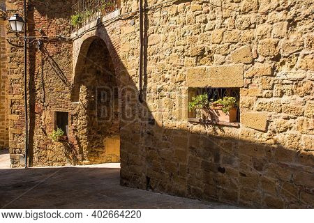 An Arched Passageway In A Quiet Residential Road In The Historic Centre Of The Medieval Town Of Mont