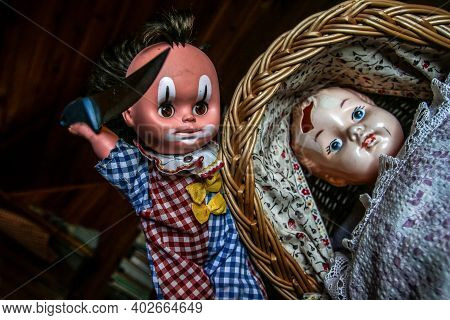 The Unused Old Doll With A Hole In Its Head Is Lying In The Baby Carriage And Looking Quite Scary An