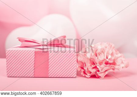 Valentine Day Gift In A Box Wrapped In Striped Paper And Tied With Silk Ribbon Bow And Heart Shaped