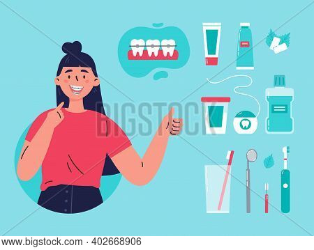 Woman Showing Her Smile With Dental Braces. Attractive Girl With Various Accessories For Daily Denta