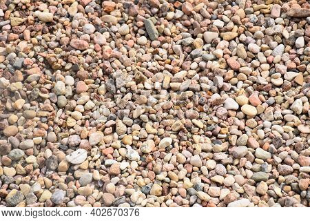 Multicolored Stones For The Background, Natural Materials, Small Stones Of Ocher Color