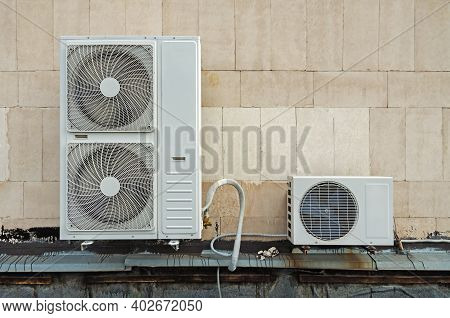 Functioning Air Compressor And Air Condenser Unit Located On Flat Roof Deck Building To Heat Release