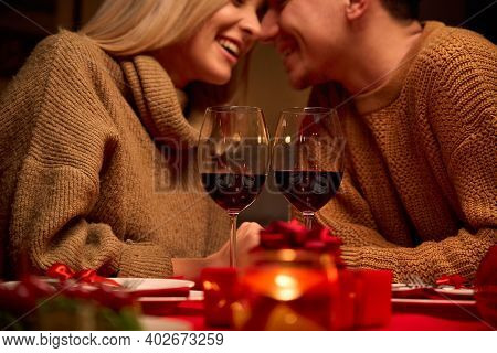 Happy Couple In Love Celebrate Valentines Day Dining At Home, In Restaurant, Having Date With Candle
