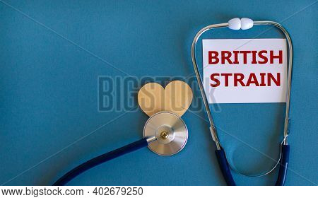 Covid-19 British Strain Symbol. White Card With Words 'british Strain' And Stethoscope On Blue Backg