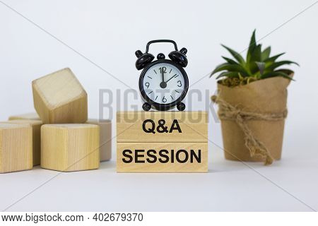 Q And A, Questions And Answers Session Symbol. Concept Words 'q And A Session' On Wooden Blocks On A