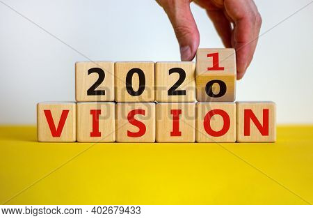 2021 Vision Symbol. Hand Turns A Wooden Cube And Changes Words 'vision 2020' To 'vision 2021'. Beaut