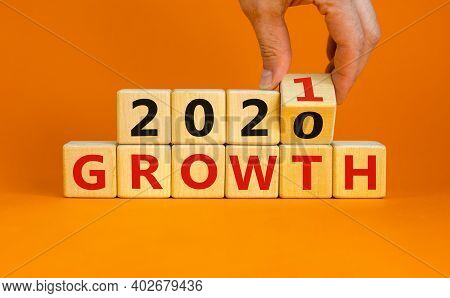 2021 Growth Symbol. Hand Turns A Wooden Cube And Changes Words 'growth 2020' To 'growth 2021'. Beaut